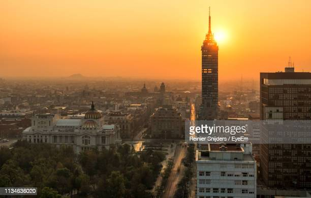 cityscape against sky during sunset - mexico city stock-fotos und bilder