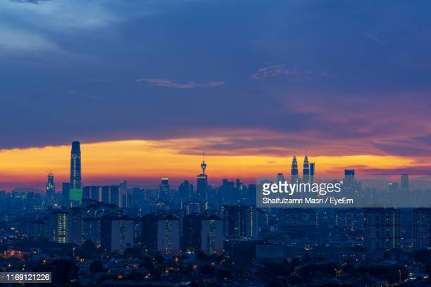 cityscape against sky during sunset - shaifulzamri - fotografias e filmes do acervo