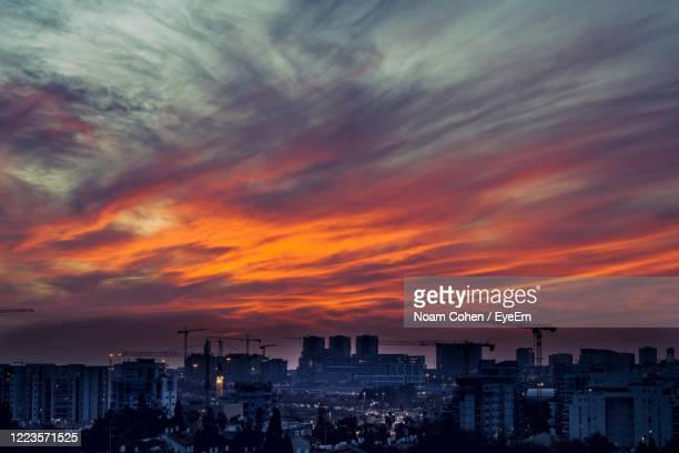 cityscape against sky during sunset - noam cohen stock pictures, royalty-free photos & images