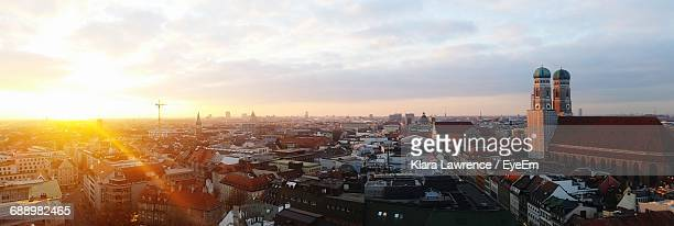 cityscape against sky during sunset - münchen stock-fotos und bilder