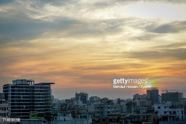 cityscape against sky during sunset - dhaka stock pictures, royalty-free photos & images