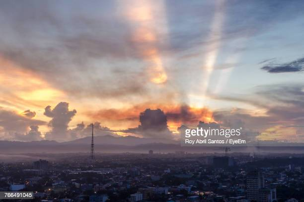 cityscape against sky during sunset - metro manila stock photos and pictures