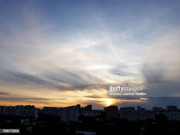 cityscape against sky during sunset - anastasi foto e immagini stock