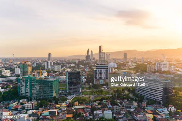 cityscape against sky during sunset - cebu stock photos and pictures