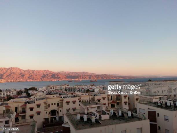 cityscape against sky during sunset - eilat stock pictures, royalty-free photos & images
