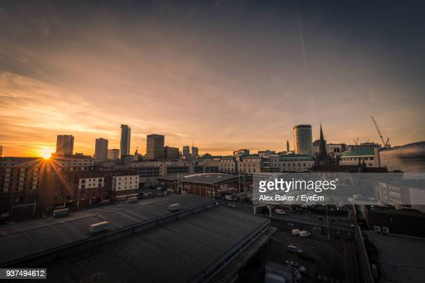 cityscape against sky during sunset - birmingham england stock pictures, royalty-free photos & images