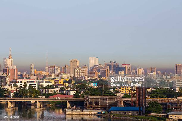 cityscape against sky - nigeria stock pictures, royalty-free photos & images