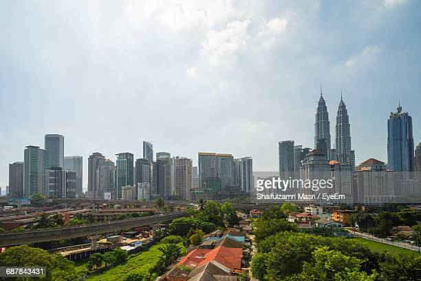 cityscape against sky - shaifulzamri stock pictures, royalty-free photos & images