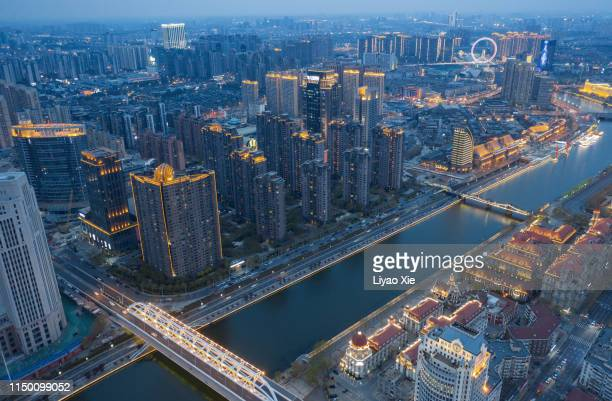 cityscape along the river - liyao xie stock pictures, royalty-free photos & images
