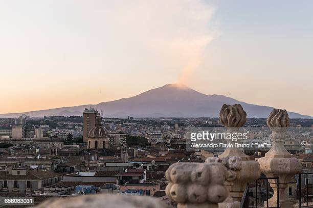 cityscape and mountain against sky - catania stock photos and pictures