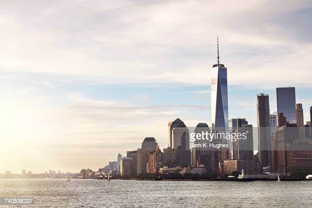 cityscape and skyline with one world trade centre, lower manhattan, new york, usa - symbolism stock pictures, royalty-free photos & images
