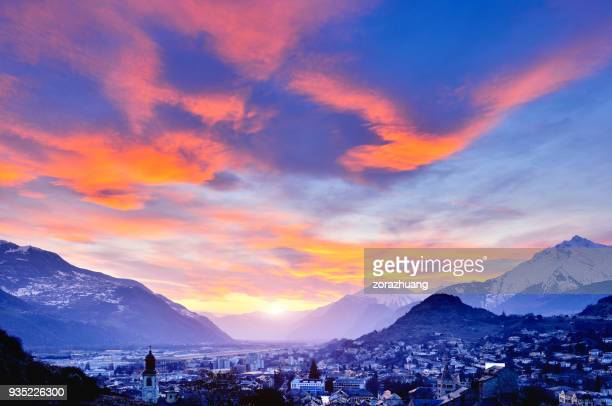 cityscape and swiss alps at dramatic sky, sion, switzerland - sion switzerland stock pictures, royalty-free photos & images