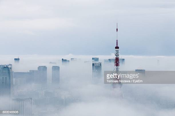 Cityscape And Tokyo Tower Covered In Clouds