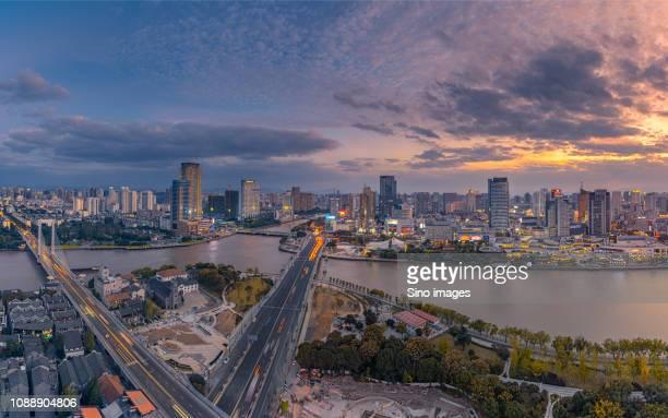 cityscape at dusk, ningbo, zhejiang, china - ningbo stock pictures, royalty-free photos & images
