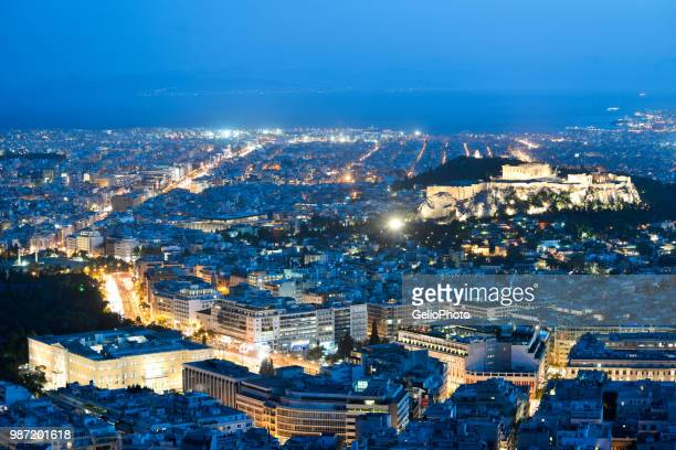 A cityscape at night in Athens, Greece.
