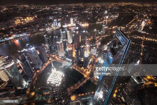 cityscape at night with skyscrapers, shanghai, china - image stockfoto's en -beelden