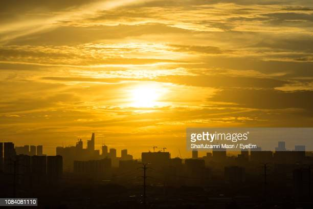 cityscape at sunset - shaifulzamri stock pictures, royalty-free photos & images