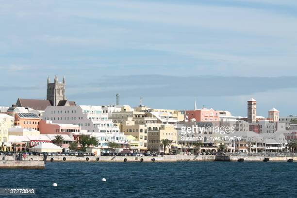 cityscape at waterfront against sky - bermuda stock pictures, royalty-free photos & images