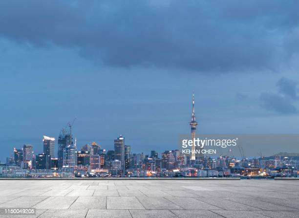 cityscape background with empty road and car park - high street stock pictures, royalty-free photos & images