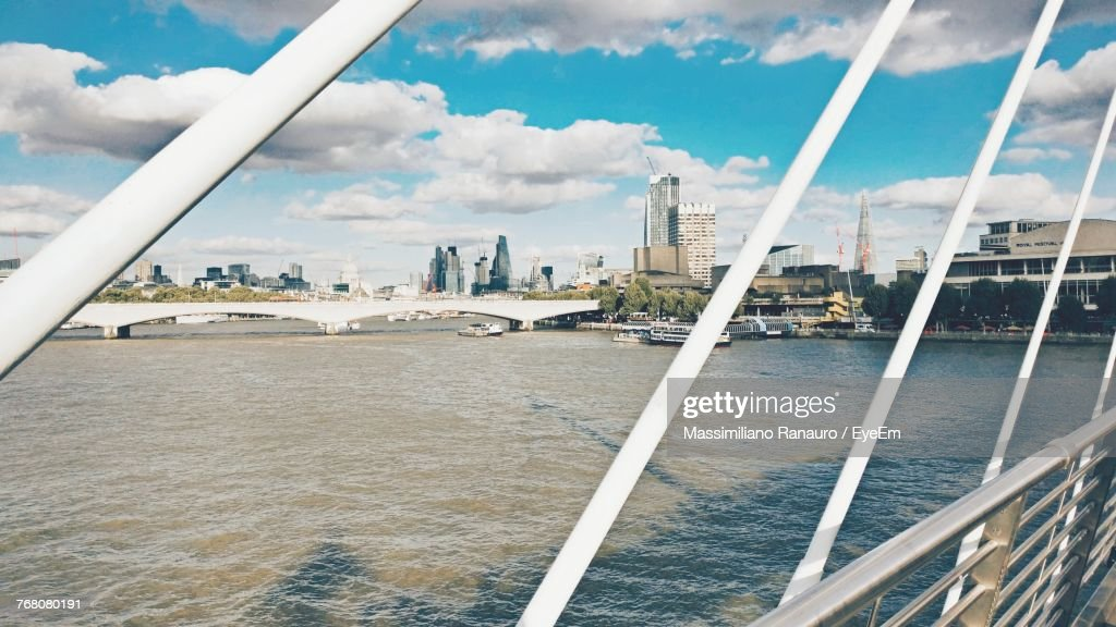 Cityscape By River Against Sky : Stock Photo