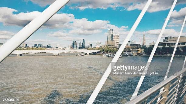 cityscape by river against sky - massimiliano ranauro stock pictures, royalty-free photos & images