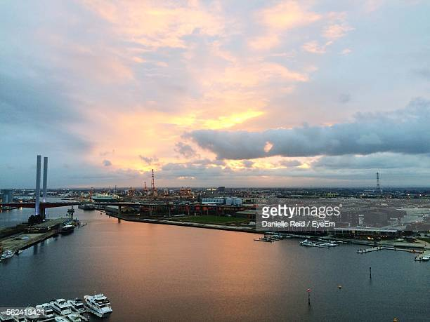 cityscape by sea against cloudy sky - danielle reid stock pictures, royalty-free photos & images