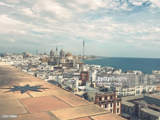 cityscape by sea against sky - jerez de la frontera stock pictures, royalty-free photos & images