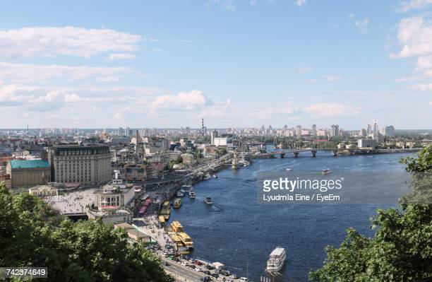 cityscape by sea against sky - kiev stock pictures, royalty-free photos & images