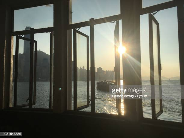 cityscape by sea seen through window - photographed through window stock pictures, royalty-free photos & images