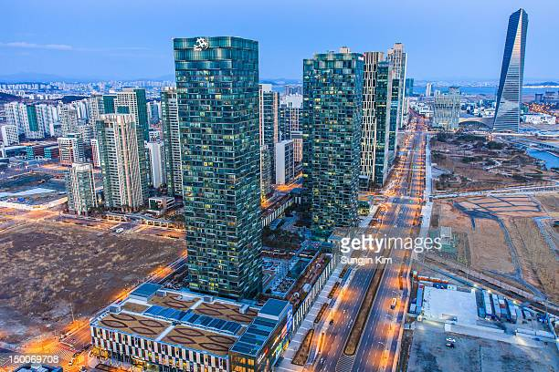 cityscape during dusk - songdo ibd stock pictures, royalty-free photos & images
