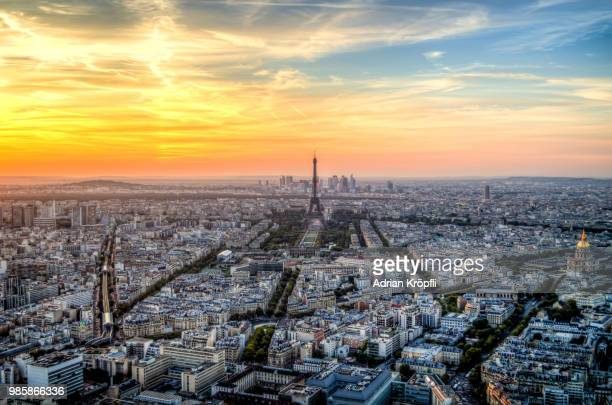 a cityscape during sunset in paris, france. - high dynamic range imaging stock photos and pictures