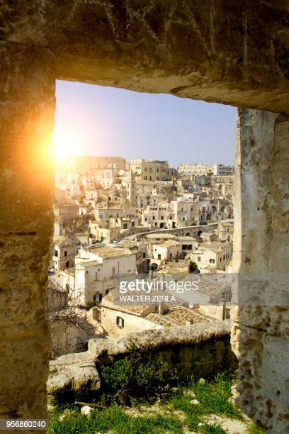 cityscape from ruin doorway, matera, basilicata, italy - matera italy stock pictures, royalty-free photos & images