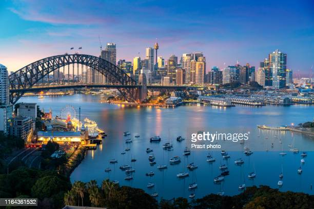 cityscape image of sydney, australia with harbor bridge and sydney skyline during sunset. vacation and travel in australia. - sydney stock pictures, royalty-free photos & images