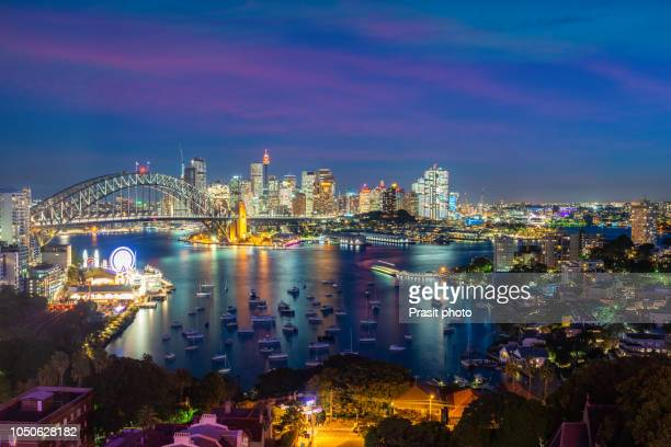 cityscape image of sydney, australia with harbour bridge and sydney skyline during sunset. - luna park sydney stock pictures, royalty-free photos & images