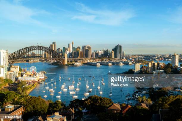 cityscape image of sydney, australia with harbour bridge and sydney skyline during summer day. - north stock pictures, royalty-free photos & images