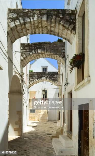 cityscape in old whitewashed town of locorotondo, puglia, italy - locorotondo stock photos and pictures