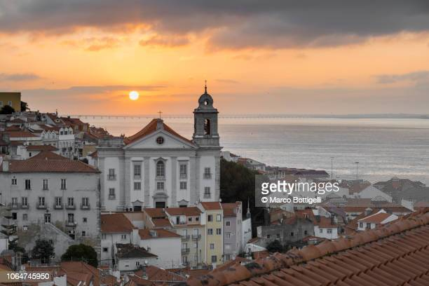 cityscape of alfama district at sunrise, lisbon, portugal - alfama stock photos and pictures