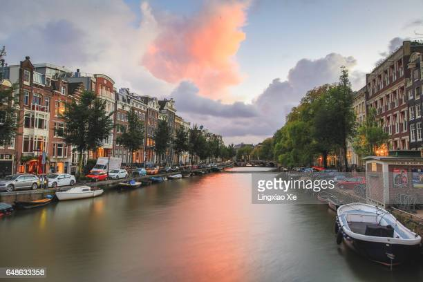 Cityscape of Amsterdam canal at dusk, Netherlands