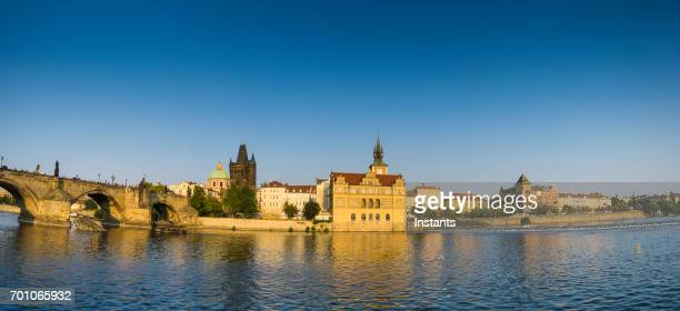 cityscape of beautiful prague, with a view of charles bridge on vltava river. - vltava river stock photos and pictures