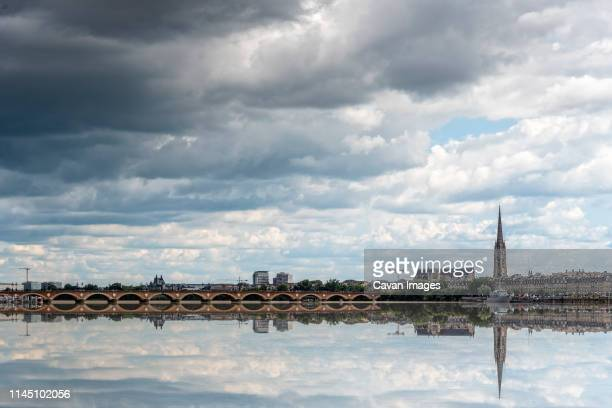 cityscape of bordeaux and reflection on water of garonne river - ボルドー ストックフォトと画像
