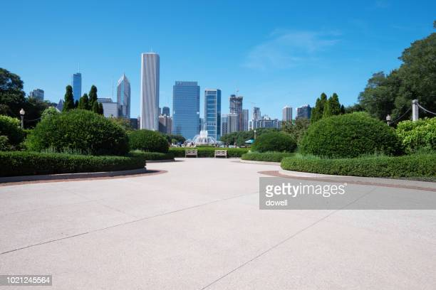 cityscape of chicago with empty street - park stock-fotos und bilder