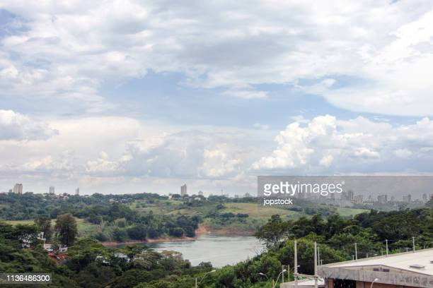 cityscape of ciudad del este city and parana river in paraguay - paraguay stock pictures, royalty-free photos & images