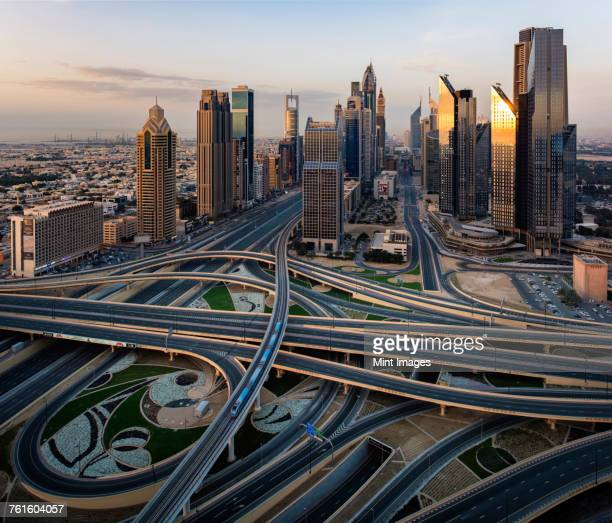 Cityscape of Dubai, United Arab Emirates, with skyscrapers and highways in the foreground.