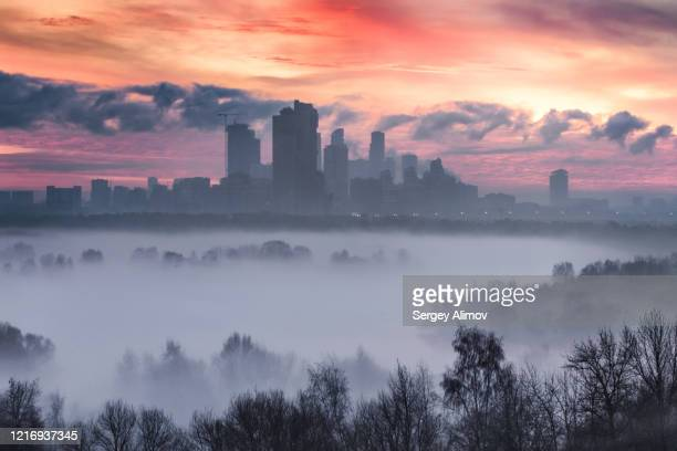 cityscape of foggy moscow and moskva river valley at dawn - moscow russia stock pictures, royalty-free photos & images