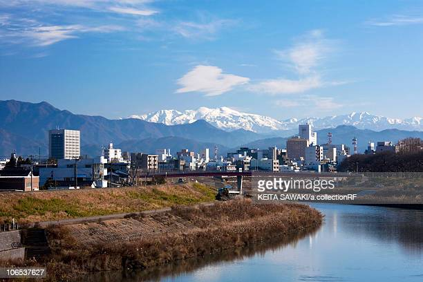 cityscape of fukui, asuwa river and mt. hakusan, fukui prefecture, honshu, japan - fukui prefecture stock pictures, royalty-free photos & images