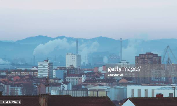 cityscape of gijón with pollution at sunrise - ヒホン ストックフォトと画像