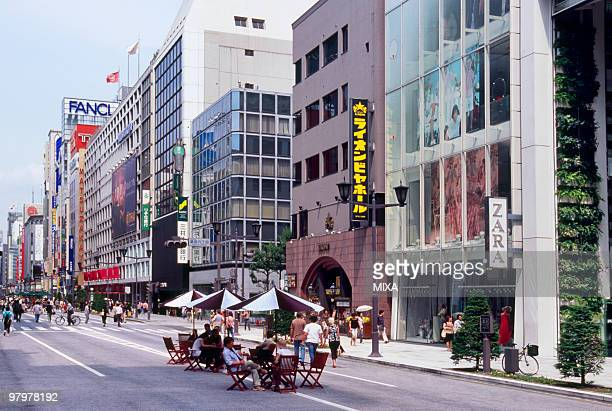 cityscape of ginza, tokyo, japan - chuo dori street stock photos and pictures