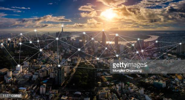 cityscape of ho chi minh city in vietnam and network connection concept , network in center of heart business district near saigon river - medical icons stock pictures, royalty-free photos & images