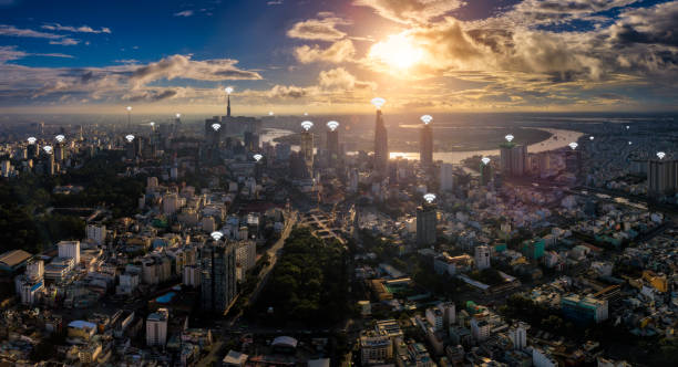 Cityscape of Ho Chi Minh City in Vietnam and network connection concept , wireless wifi network in center of heart business district near Saigon river