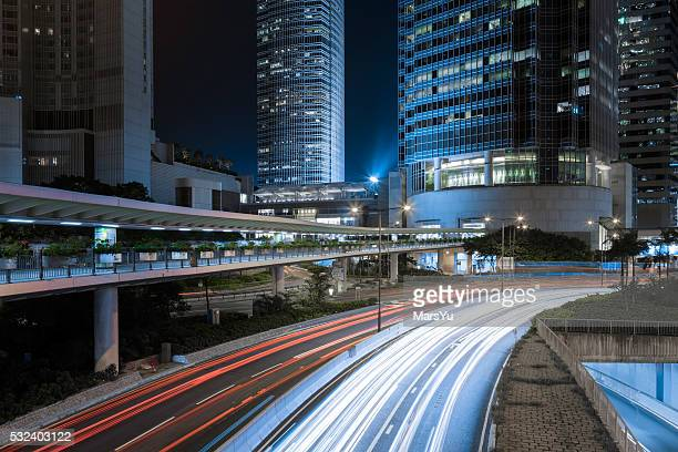 cityscape of hong kong - vehicle light stock photos and pictures